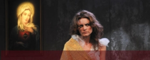 Katerina (Alice Parkinson) stares daggers at someone with a mobile phone in the audience